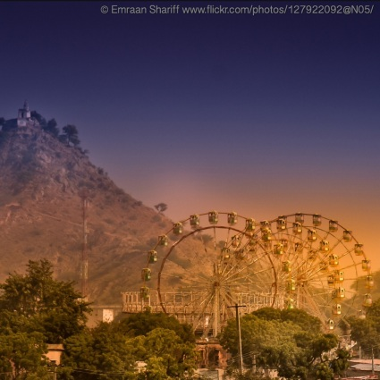 Ferris Wheels at fair near Mount in Pushkar