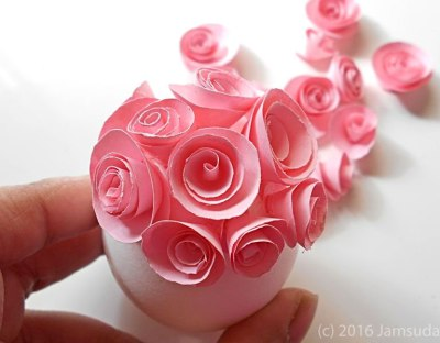 Gluing Pink Rosettes to Egg