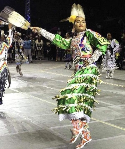 Acosia Red Elk competes at the Gathering of Nations powwow in Albequerque, New Mexico. Red Elk won the Jingle Dancing division for the eighth time.