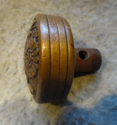 Side View: Antique Flower Door Knob Made by Russell & Erwin - source: AntiqueDoorHardwareCollector.com