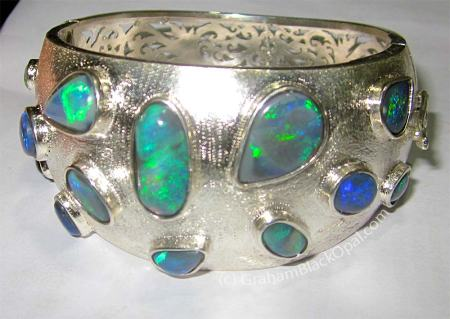"Opal Cuff Bracelet by <a href=""http://www.grahamblackopal.com"" target=""_blank"">Graham Black Opal Jewelry</a>"